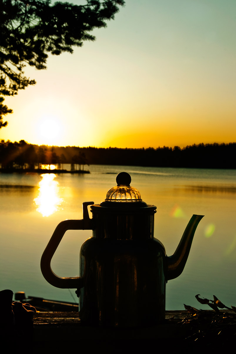 Morning coffee by lake in Sweden